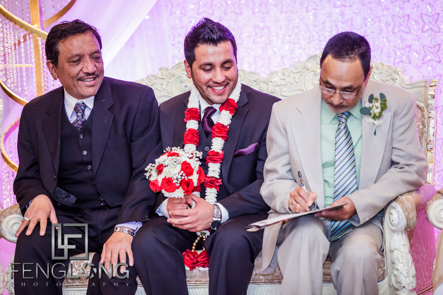 Groom and father signing marriage contract