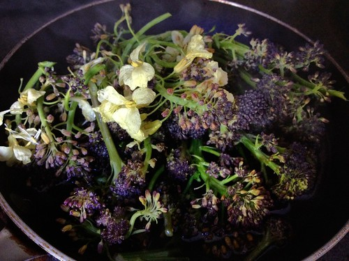 Purple Sprouting Broccoli being steamed in pan