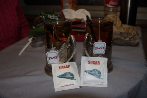 РЖД (Russian Railways) branded tea and sugar packets