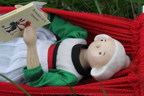 Becassine relaxes with a favorite book
