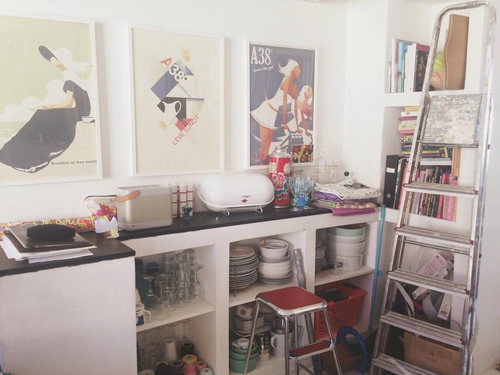 Retro posters in boho kitchen