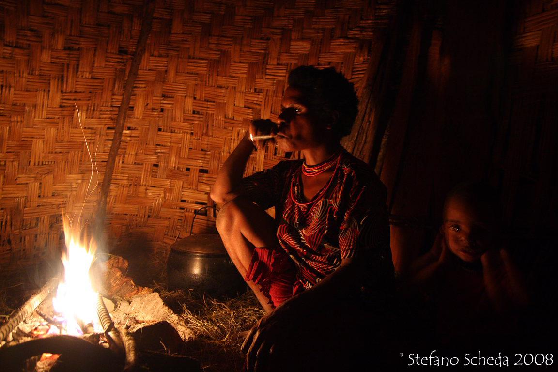 Dani family fireplace - Irian Jaya, Indonesia