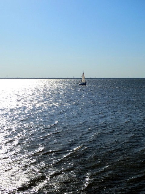 sailboat in lake hefner sun