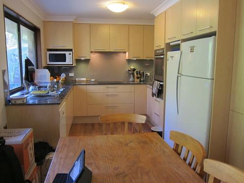 Kitchen now with splashback and under cabinet lights