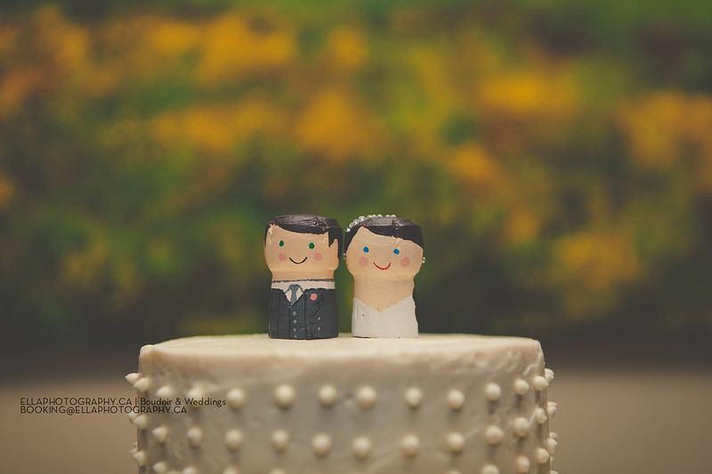 Cake-toppers made out of the champagne corks from our engagement party!