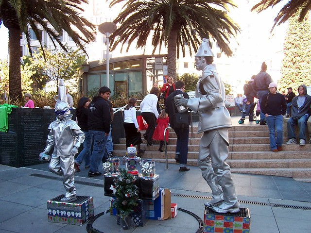 Tin man and child street performers