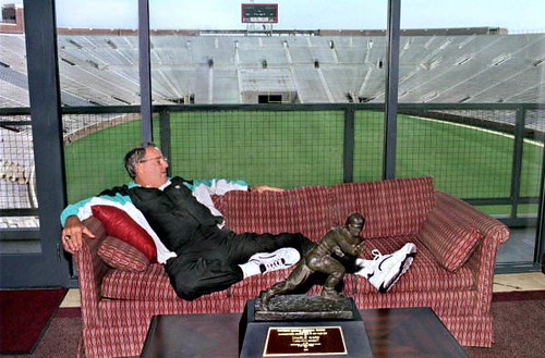 Bobby Bowden relaxing with Charlie Ward's Heisman trophy: Doak Campbell Stadium, Tallahassee