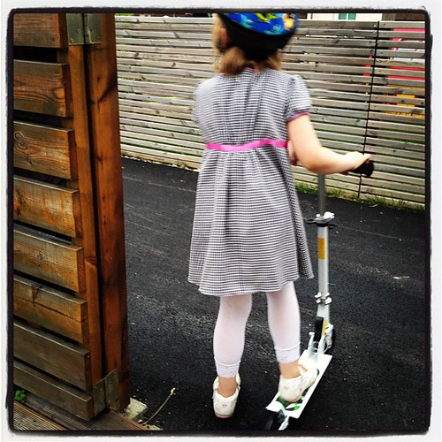 Trying out the scooter she bought with her birthday money