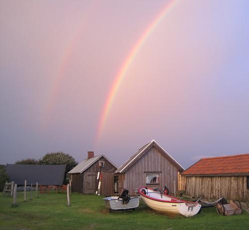 Fishing huts with rainbows