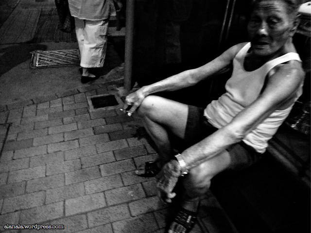 Old man chilling on the street