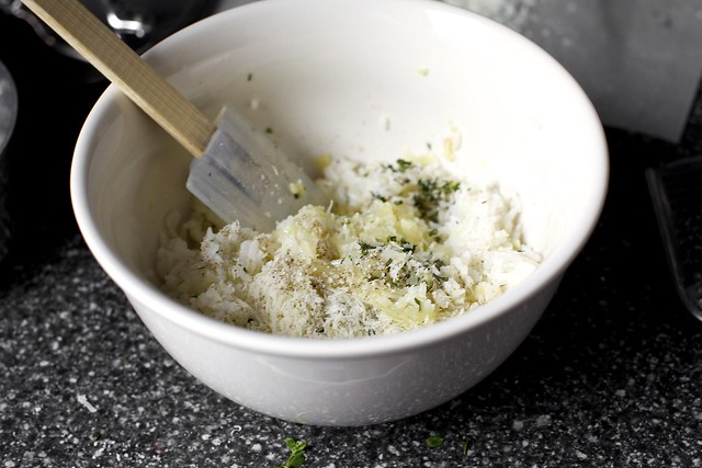 mixing rice, onions, herbs, parmesan