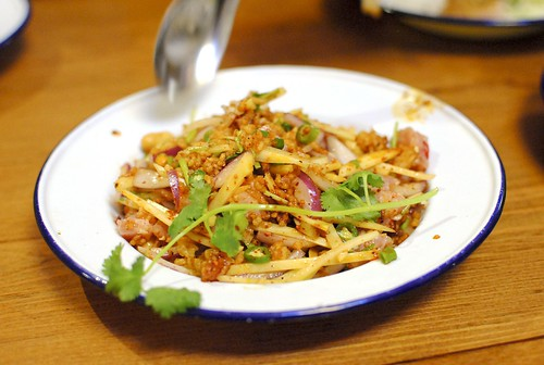 nam kao tod | crispy rice salad spicy fermented pork, bird eye, ginger, chile jam, fish sauce, lime, peanuts