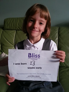 Millie holding up BLISS literature