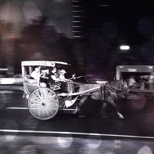 Horse drawn transport. Taken 9.29.12 #iphone4s #iphoneonly #iphoneography #blackandwhite #monochrome #manila #philippines #igersasia #igersmanila #igersphilippines #snapseed #lensflare #instagood #calesa