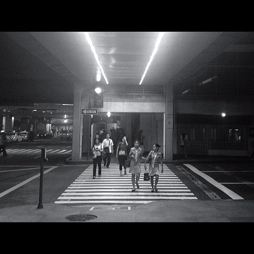 Ped X-ing. Taken 10.20.12 Makati City, Philippines. #iphone4s #photographyeveryday #igersasia #igersmanila #igersphilippines #pedestrian #street #structure #makati #manila #philippines #cityscape #blackandwhite #lensflare #monochrome #crossing #instagood