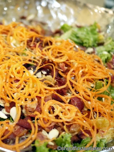 Bizu Private Caterer- mandarin orange & roasted almond salad with crisp  bacon in honey orange  yogurt dressing