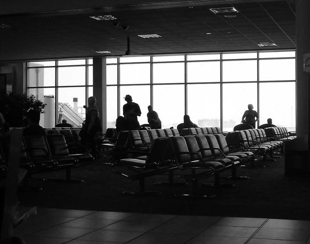 Calgary airport black and white window with people silhouette