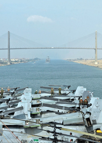 USS Iwo Jima approaches the Friendship Bridge. by Official U.S. Navy Imagery