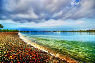 #850E2031 - Clear water and dark clouds