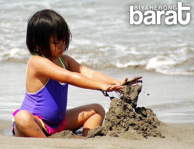 child making sand castles in san juan la union philippines