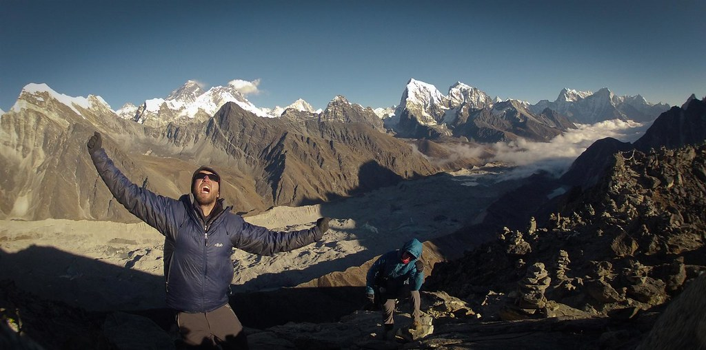 Himalayan dreamers from Gokyo Ri (5355m). Debris covered Ngozumba Glacier, Everest, Lhotse, Cholatse and friends loaming behind.