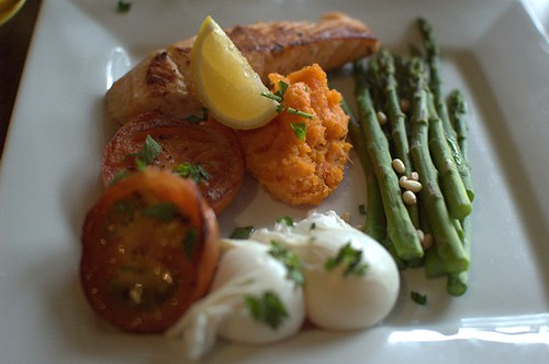 Two poached free range eggs, grilled tomato with basil, grilled asparagus with pine nuts, sweet potato mash, salmon fillet