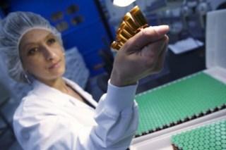 Inspecting vaccine vials (Sanofi Pasteur)