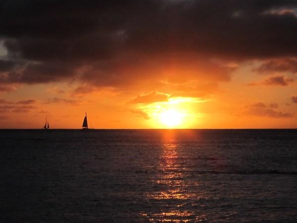 Sunset over Kaimana Beach in Waikiki.
