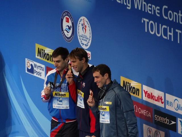 The Istanbul 2012 men's 100 back medal podium