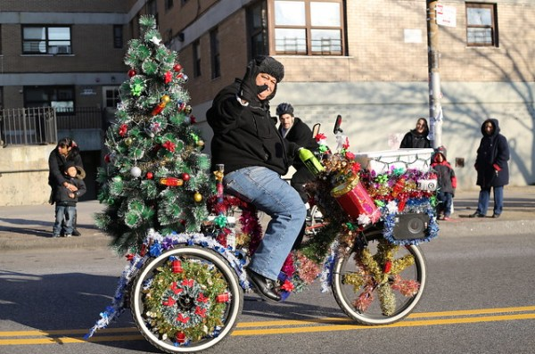 Man on bicycle with tree at Three Kings' Day Parade