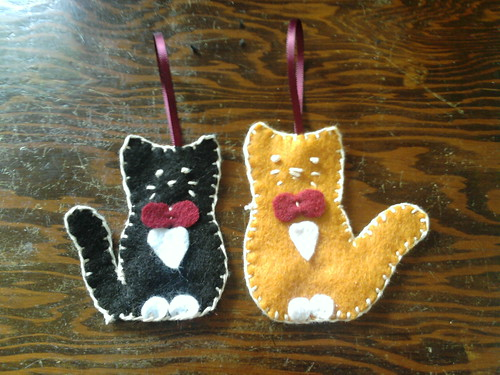 black and white cat hand stitched felt ornment and orange and white handstsitched cat felt ornament
