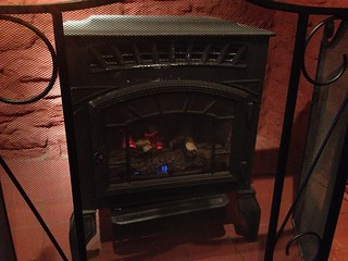 Stove in fireplace, Vennels Café, Durham