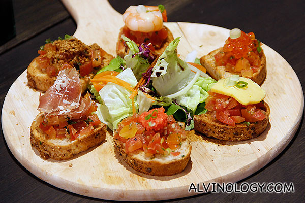 Mixed Crostini - grilled bread topped with Tomato Concasse, Chilled Shrimps, Salmon Roe, Tamagoyaki Egg, and Smoked Salmon (S$18)