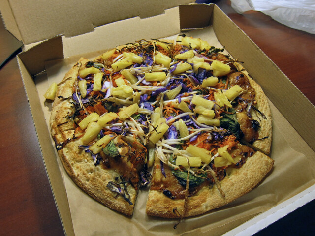 Round pizza in a delivery box.