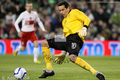 David Forde saves with his feet against Poland