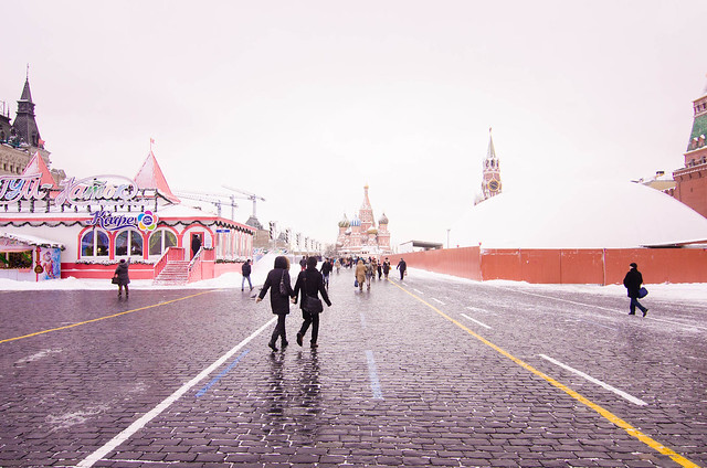 Red Square in Moscow. Kremlin to the left, behind the big white domey thing. GUM fancy-pants department store to the left, behind the temporary ice skating rink. St Basil's Cathedral in the centre.