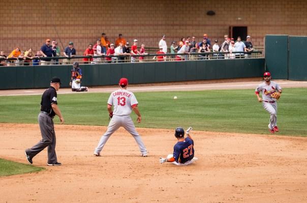 Houston's Jose Altuve (#27) is safe as he slides into 2nd base against St. Louis' Matt Carpenter (#13)