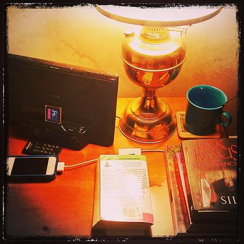 Feb 25 - on your bedside table {lamp, iPod dock/alarm, assortment of books, iPhone charging, mug of hot lemon} #fmsphotoaday