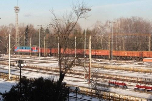 Grup Feroviar Român hauled coal train passes through Brașov station