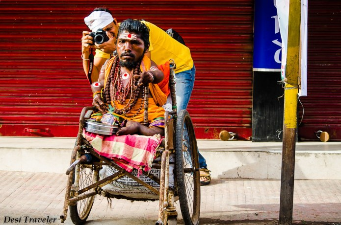 photographer clicking picture with a man in wheelchair