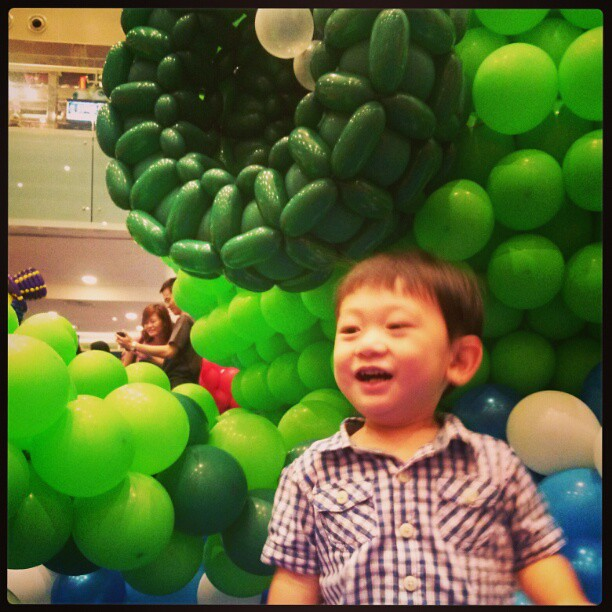 Asher having the time of his life at a balloon sculpture exhibition