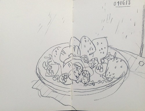 Berries in dish on loose leaf