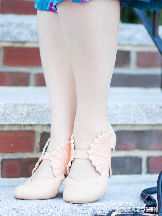 Peach-pink shoes by Miss L Fire feature a faux snakeskin seashell on the side of the foot
