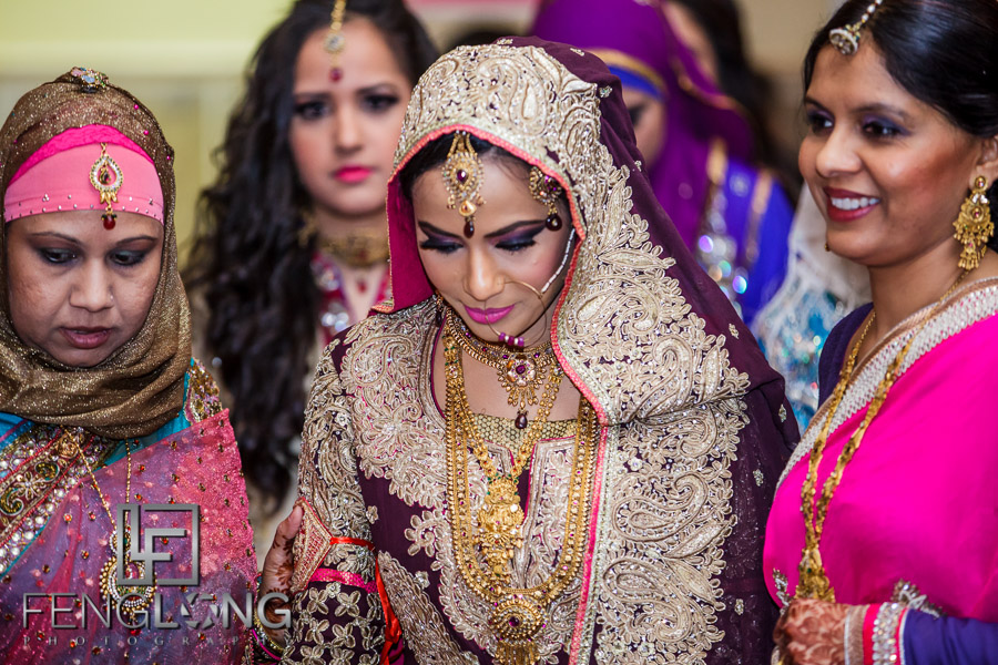 Indian bride makes her entrance to Muslim wedding ceremony