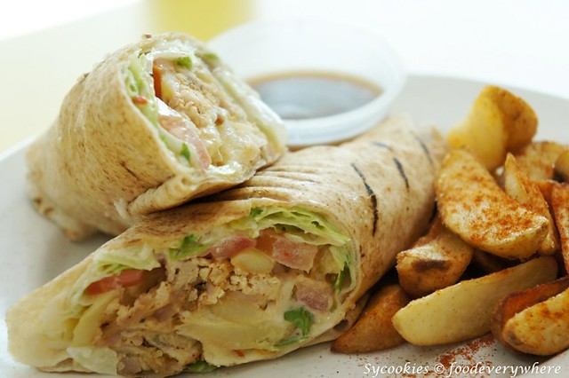 22.2Tropical Chicken Wrap Combo-Chicken coleslaw, chips with garlic cheese mayonnaise wrapped in pitta bread-chargrill express