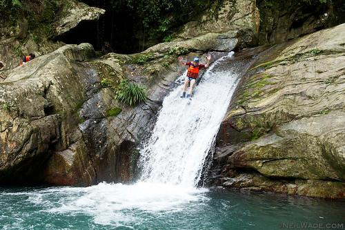 Slinding down a waterfall in Taiwan