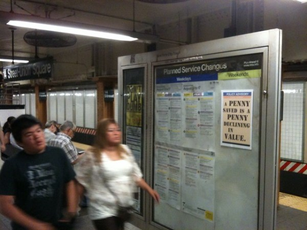 POLICY ADVISORY A penny saved is a penny declining in value. (Union Square; L train Platform)