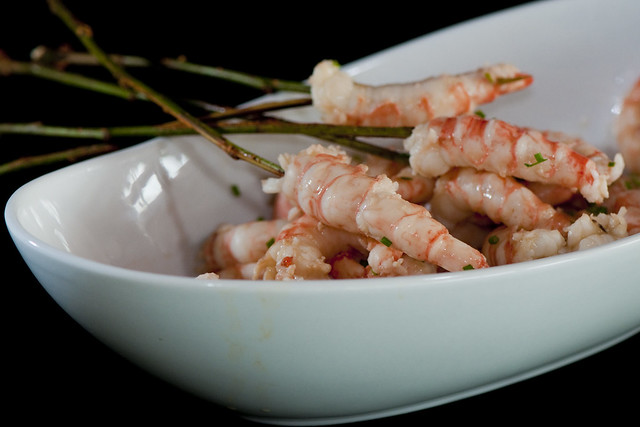 Skewered Spot prawns in a miso Hoisin broth with fresh chives
