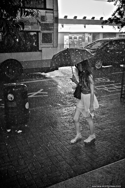 Lady in pouring rain