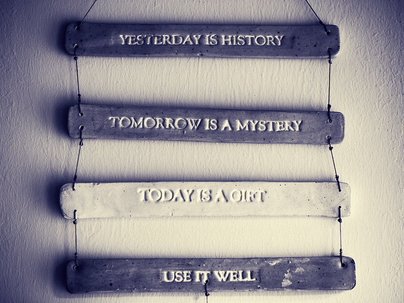 """Decorative quote hanging on a wall with the words """"Yesterday is history, Tomorrow Is a Mystery, Today is a Gift, Use It Well"""". (Kamo Photos)"""